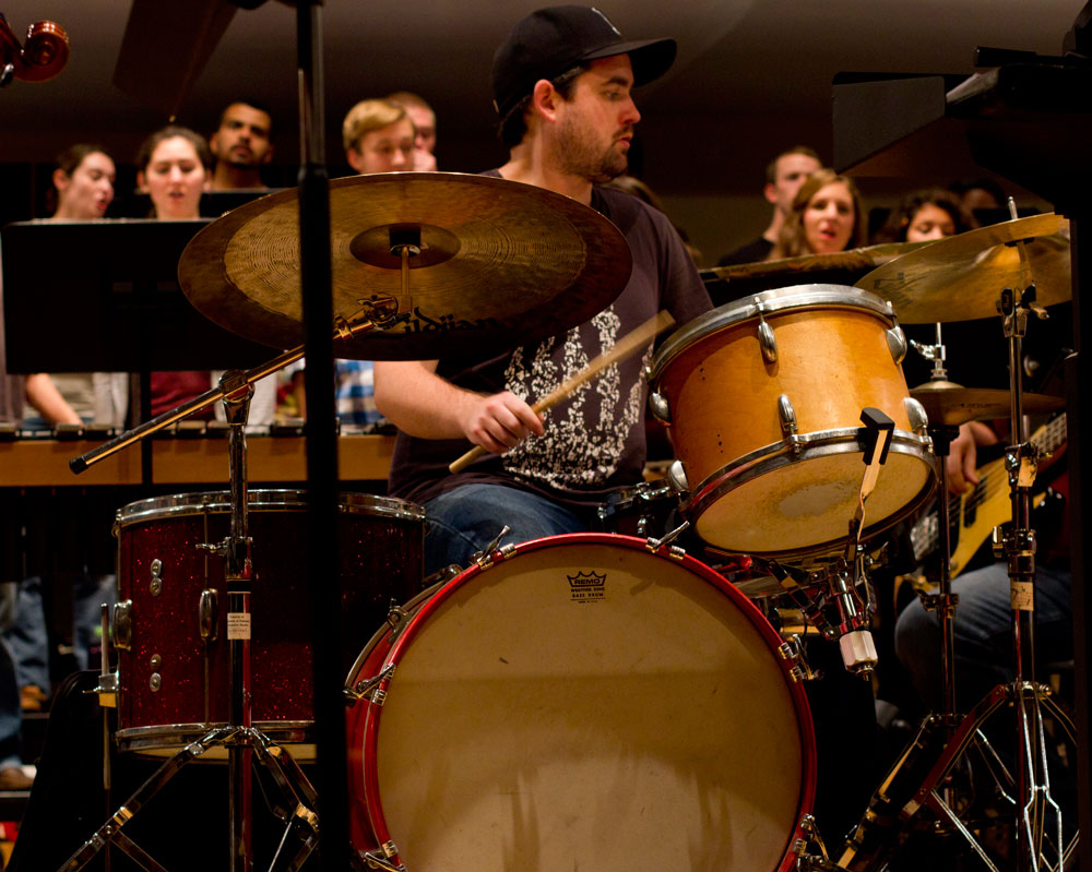 drummer seated at drum kit